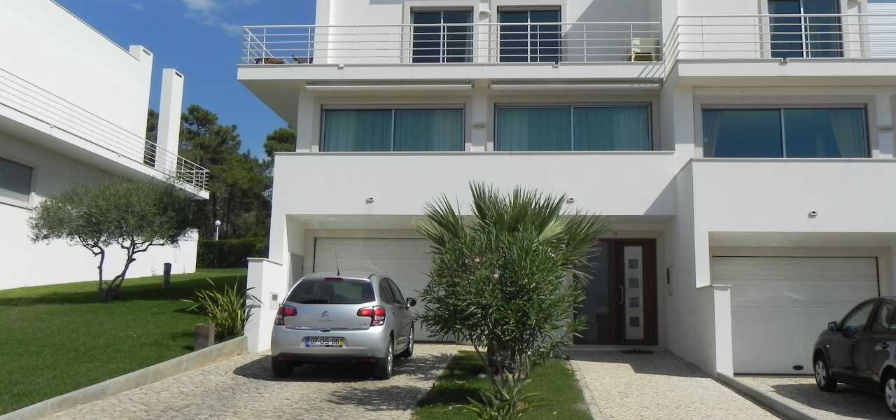 4-bed contemporary attached villa in a gated condominium...
