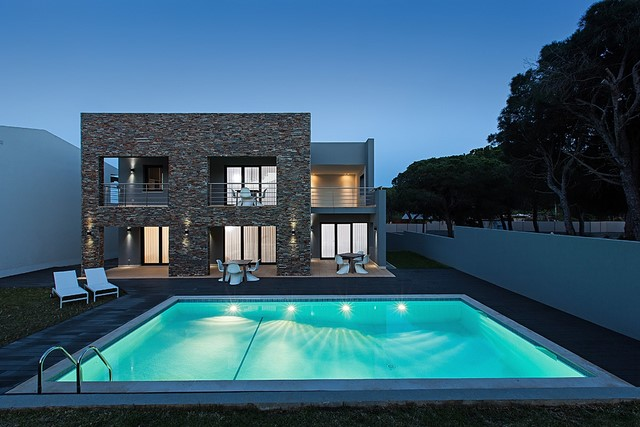 Contemporary villa with pool in quiet urbanisation close to the beach